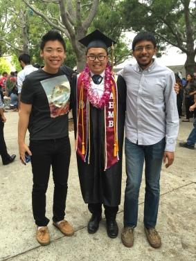 Xiang and Arjun congratulate Kyle at graduation, 2016