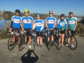Members of group and friends ride in their IDT jerseys, 2017