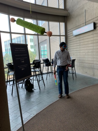 Arjun about to mutate the OrthoRep plasmid with a stick, 2018